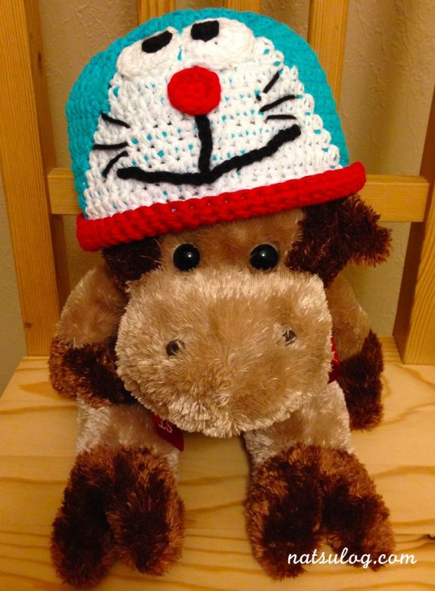 A Doraemon beanie on my stuffed cow