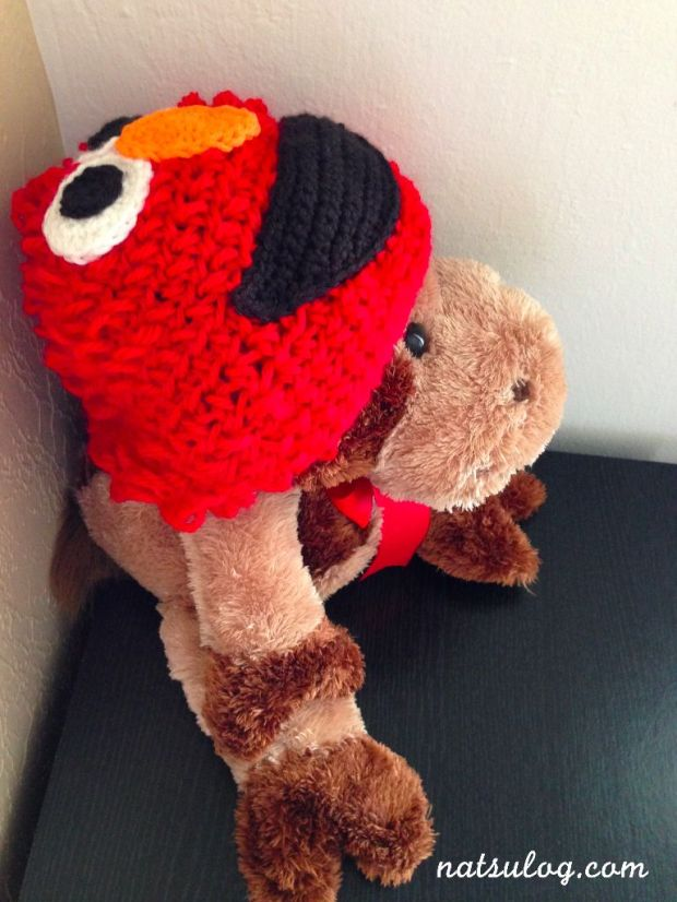 Elmo Baby Beanie on my stuffed cow