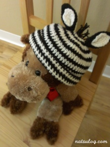 A zebra beanie on my stuffed cow