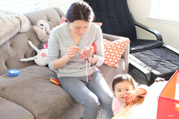 mommy-crocheting-with-a-baby